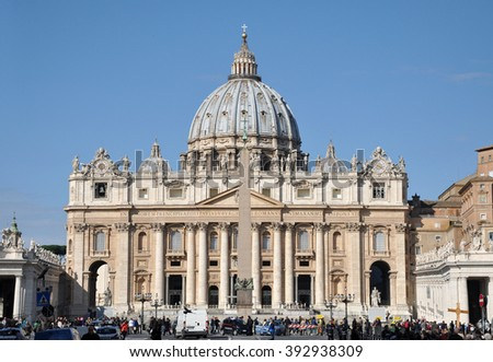 VATICAN CITY - MARCH 14, 2016: Tourists visiting the famous Saint Peter square and the Basilica of San Pietro in Vatican City - stock photo
