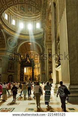 VATICAN CITY, VATICAN - JULY 15 2014: People at the interior of the Saint Peter Cathedral in Vatican. Saint Peter's Basilica has the largest interior of any Christian church in the world.