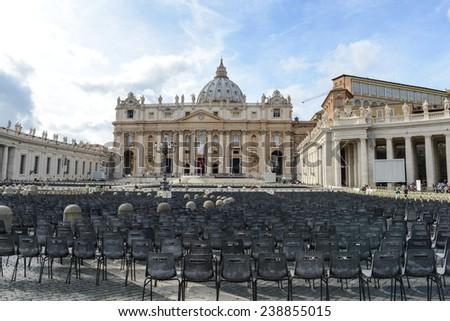VATICAN CITY, VATICAN - OCTOBER 17: Tourists at Saint Peter's Square on October 17, 2014 in Vatican City, Vatican. Saint Peter's Square is among most popular pilgrimage sites for Roman Catholics. - stock photo