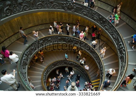 VATICAN CITY, VATICAN STATE - SEPTEMBER 27, 2015: People descend the modern double helix staircase designed by Giuseppe Momo in 1932, Vatican Museums
