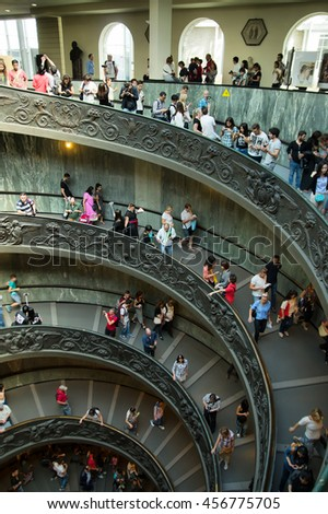 VATICAN CITY, VATICAN STATE - SEPTEMBER 27, 2015: People descend the modern double helix staircase designed by Giuseppe Momo in 1932, Vatican Museums - stock photo