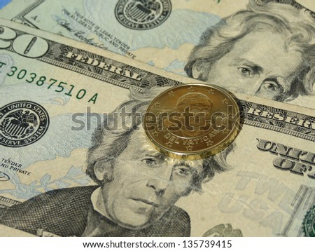 Vatican dollars (Vatican Euro coin depicting former Pope Benedict XVI and USD banknotes) - stock photo