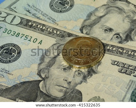 Vatican EUR coin and USA Dollar banknotes currency of the United States - stock photo