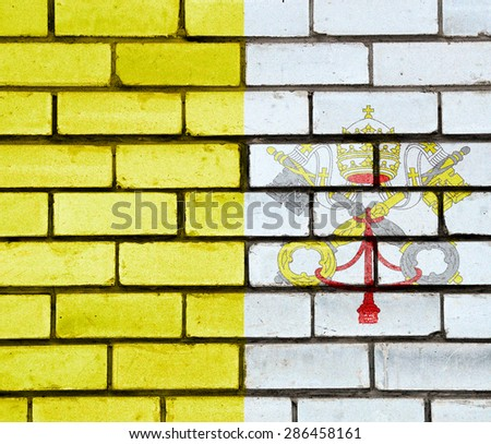 Vatican flag painted on old brick wall texture background - stock photo