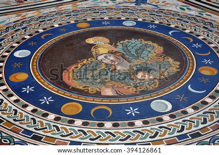 VATICAN, ITALY - MARCH 14, 2016: The mosaic tiled floor in the Greek Cross Hall is one of the major attractions of the Vatican Museum and is visited every year by crowds of people - stock photo
