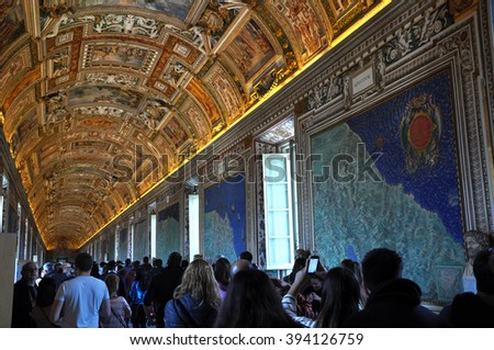 VATICAN, ITALY - MARCH 14, 2016: Tourists visiting the famous Gallery of Maps in the Vatican Museum, one of the major tourist attraction of the Vatican Museums - stock photo