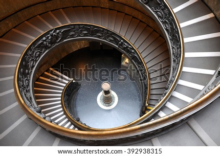VATICAN - MARCH 15, 2016: The spiral staircase in the Vatican Museum is visited daily by thousands of tourists on the way of the exit from the museum