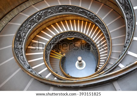 VATICAN - MARCH 15, 2016: The spiral staircase in the Vatican Museum is visited daily by thousands of tourists on the way of the exit from the museum - stock photo