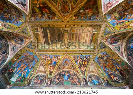 VATICAN - MAY 14, 2014: The ceiling in one of the rooms of Raphael (Stanze di Raffaello) in the Vatican Museum, Rome, Italy. - stock photo