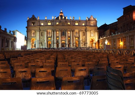 Vatican Museum in Basilica of St. Peter and  rows of gray chairs at evening in Rome, Italy - stock photo