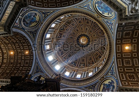 VATICAN - SEPTEMBER 18: Light entering in the dome on Saint Peter Cathedral in Vatican at September 18, 2012. Saint Peter's Basilica has the largest interior of any Christian church in the world. - stock photo