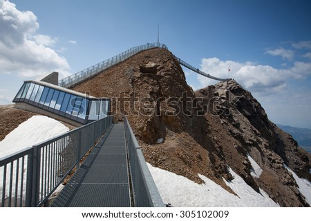 Vaud,Switzerland - July 11,2015: Peak Walk bridge.Peak Walk is a pedestrian suspension bridge linking two mountain peaks in the Swiss Alps - stock photo