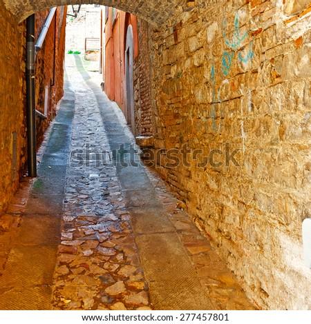 Vault over a Narrow Street in the Italian City of Todi - stock photo