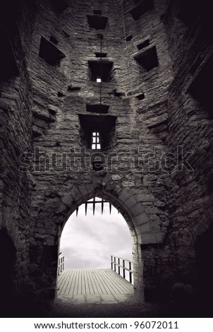 Vaulted medieval castle gate with portcullis - stock photo