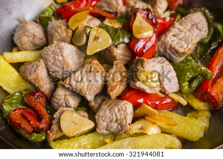 Veal bits with peppers and fries - stock photo