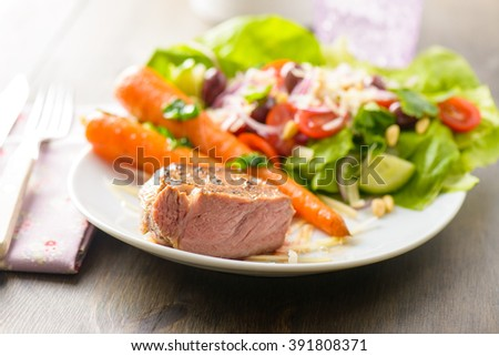 Veal chop on plate ready to be eaten - stock photo