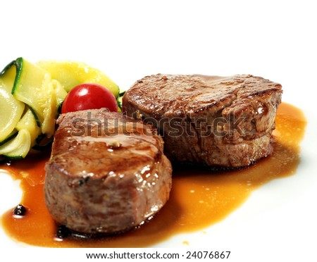 Veal Medallions with Zucchini and Cherry Tomato. Isolated on White Background - stock photo