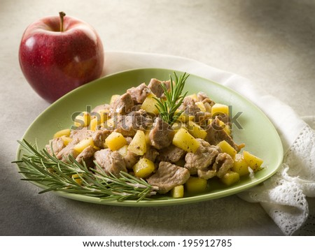 veal stew with apple and rosemary - stock photo