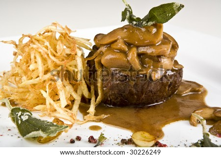 veal with CE-PS and potato chips - stock photo