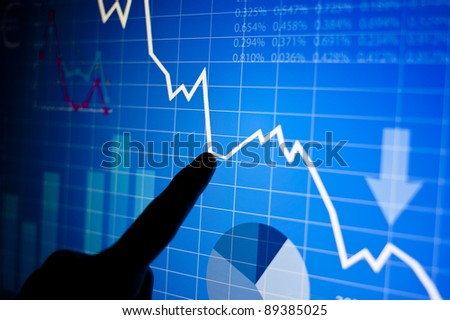 Vector illustrations of graphs and business elements on a monitor - stock photo