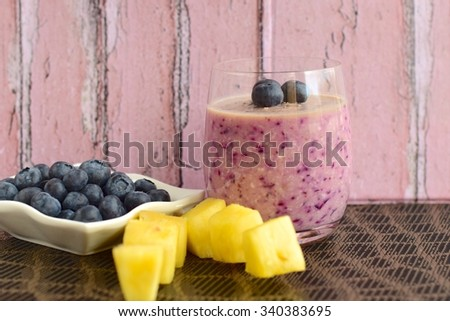 Vegan blueberry pineapple smoothie - stock photo