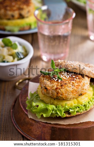 Vegan burgers with beans and vegetables served with pineapple - stock photo