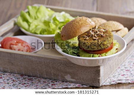 Vegan burgers with chickpeas served with fresh vegetables - stock photo