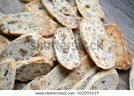 Vegan cantuccini cookies with nuts on wooden table - stock photo