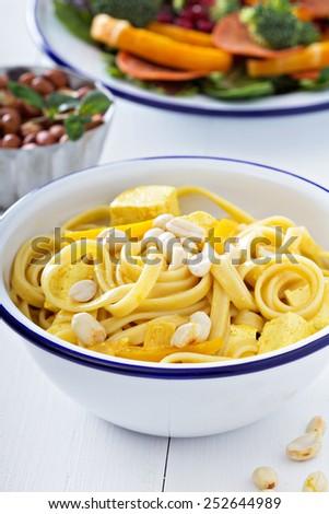 Vegan curry pasta with tofu and peanuts - stock photo