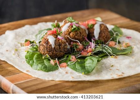 Vegan Falafel Wrap With Salsa and salad - stock photo