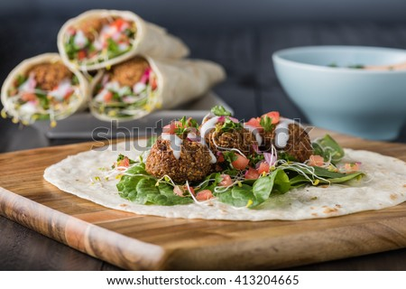 Vegan Falafel Wrap With Salsa and salad - stock photo