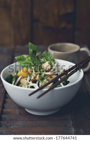 Vegan Pad Thai with fresh spinach  - stock photo
