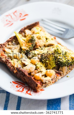 vegan pizza pie with broccoli, mushrooms and chickpeas dough with cauliflower, healthy lunch, rustic