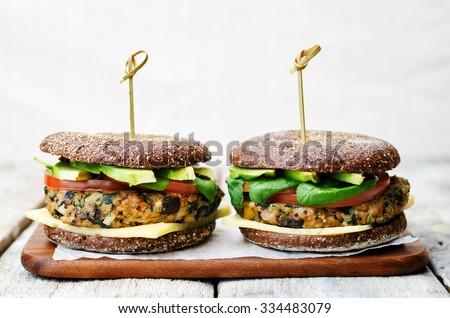 vegan quinoa eggplant spinach chickpeas rye Burger. toning. selective focus - stock photo