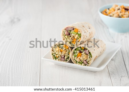 Vegan quinoa wraps with chickpea, kidney beans and pumpkin - stock photo