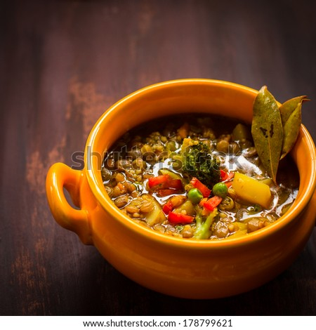Vegan red lentil and vegetable soup. Selective focus  - stock photo