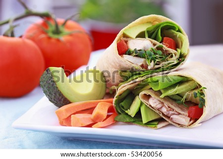 Vegan sandwich wrap with Lavish bread made from flax, oats and whole wheat. Stuffed with fresh spinach, sprouts, mushrooms, red peppers and avocados for a healthy lunch. - stock photo