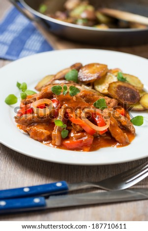 vegan soy goulash with fried potatoes - stock photo