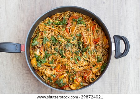 Vegan spaghetti with tofu and pepper delicious on pan from above - stock photo