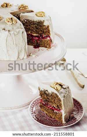 Vegan Walnut Lingonberry Cake with Cashew nut + Almond Frosting, selective focus