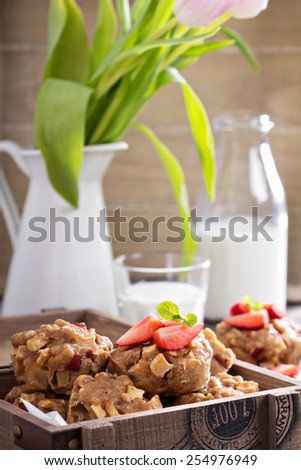 Vegan whole wheat apple muffins with strawberries - stock photo
