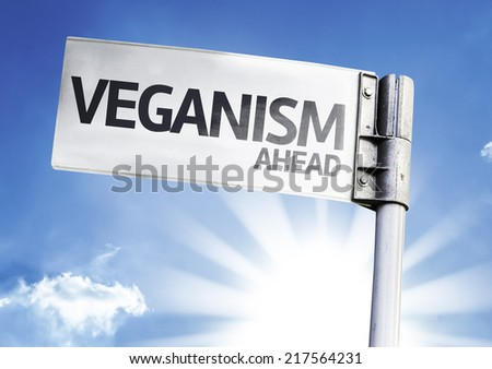 Veganism Ahead written on the road sign - stock photo