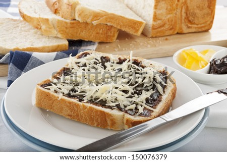 Vegemite sandwich with shredded cheese ready to serve. - stock photo