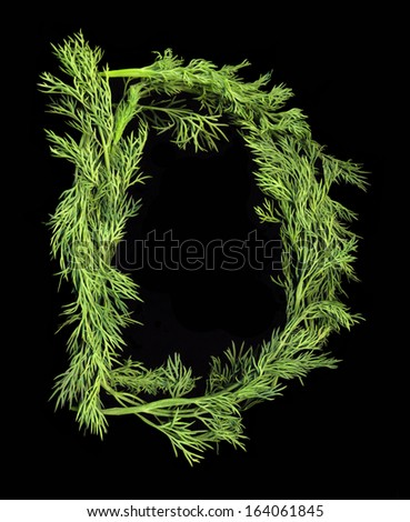 Vegetable Alphabet of sprigs of dill isolated on a black background. Letter D - stock photo