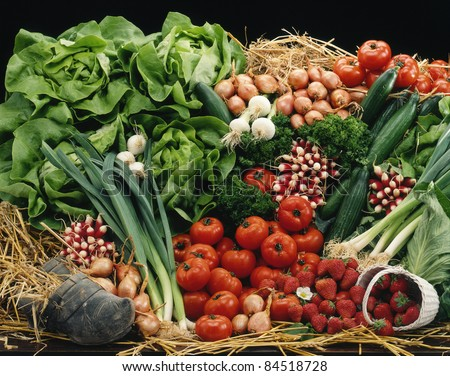 Vegetable and fruit composition on straw - stock photo