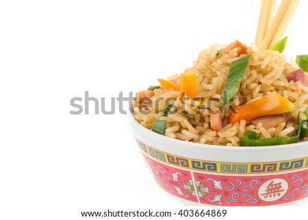 Vegetable and ham fried rice in chinese bowl, isolated background