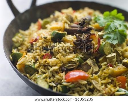 Vegetable Biryani in a Large Karahi pan - stock photo