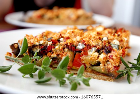 Vegetable casserole on white plate - stock photo