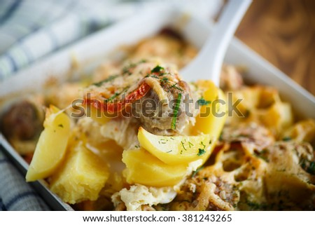 Vegetable casserole with potatoes and meatballs in a ceramic form - stock photo