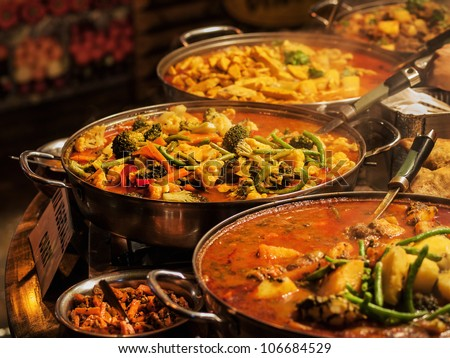 Vegetable curry - Indian takeaway at a London's market - stock photo